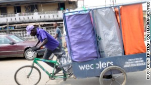 Tricycles driving slum waste revolution