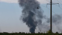 Smoke rises from a downed Ukrainian army helicopter outside Slovyansk on Thursday.