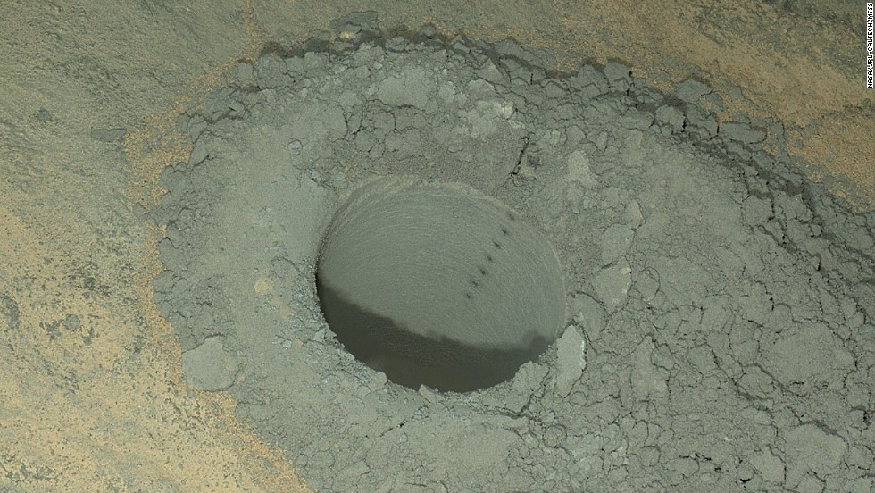 NASA's Mars rover Curiosity took this nighttime photo of a hole it drilled May 5 to collect soil samples. NASA said this image combines eight exposures taken after dark on May 13. The Curiosity rover set off from Earth in November 2011 and landed nearly nine months later -- 99 million miles away.