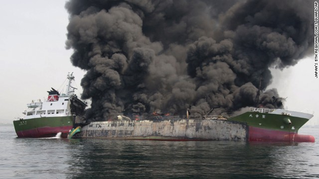 Clouds of black smoke billow from a Japanese oil tanker after it exploded.