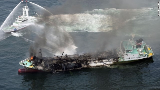 Japanese Coast Guard ships fight a fire after an Japanese oil tanker exploded.
