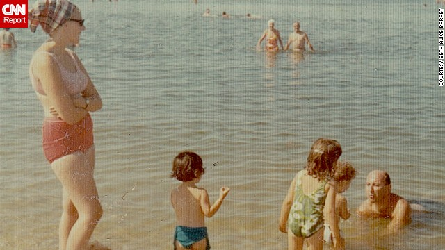 "This family photo from a 1965 trip to Long Island, New York, has special meaning for <a href='http://ireport.cnn.com/docs/DOC-728247'>Beth Alice Barret</a> all these years later. She's not pictured, but her dad is seen here playing with her then-2-year-old brother. ""These special moments mean so much to my family because a few years later, our father died suddenly,"" she said. This photo kept that moment alive for her."