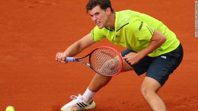 Thiem stretches to return a ball during his two-hour encounter against Nadal at Roland Garros.