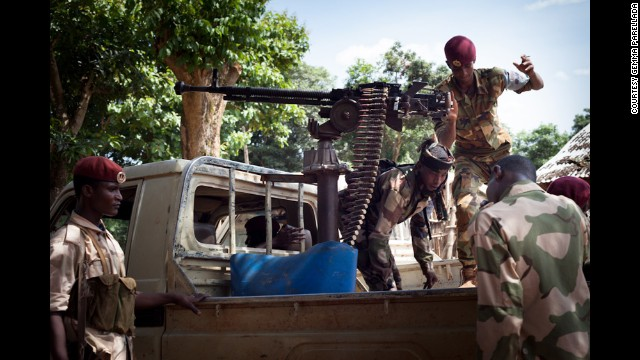 Members of the Republican Forces climb into a pickup truck to patrol the area. This group was involved in clashes with anti-balaka militia outside Bambari, and two were wounded.