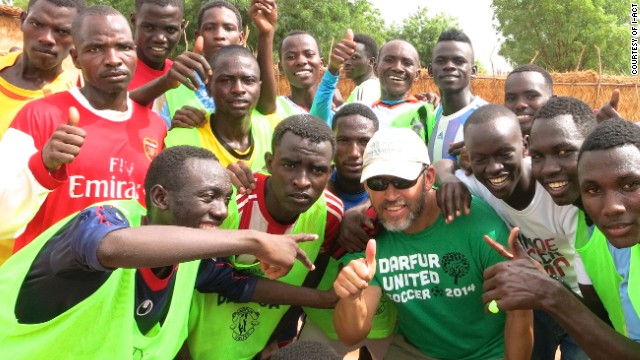 The Darfur players pose with i-ACT founder and executive director Gabriel Stauring ahead of the trip to Ostersund.