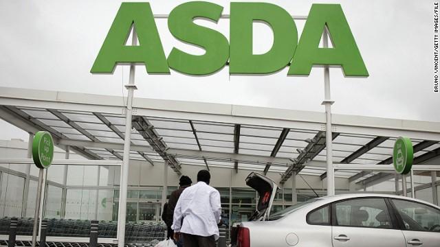 Customers enter an ASDA store in London, England.
