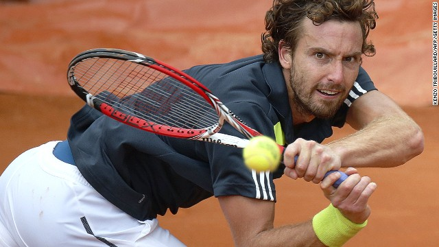Ernests Gulbis returns to Radek Stepanek during their third round match at Roland Garros.
