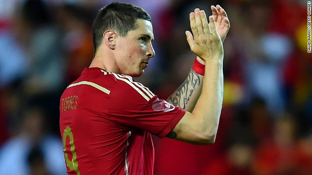 Fernando Torres applauds the crowd after being substituted in Spain's 2-0 win over Bolivia in Sevilla.