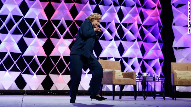 Clinton ducks after a woman threw a shoe at her while she was delivering remarks at the Institute of Scrap Recycling Industries conference in Las Vegas on April 10.