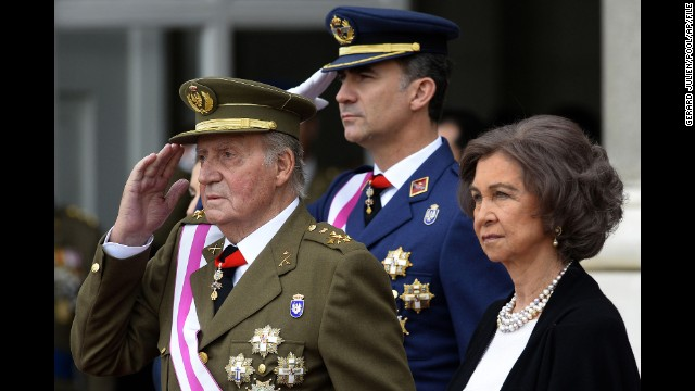 Spain's King Juan Carlos I, left, announced Monday, June 2, that he would be handing over the throne to Crown Prince Felipe, center. Juan Carlos, 76, oversaw Spain's transition from dictatorship to democracy after the death of Francisco Franco in 1975.