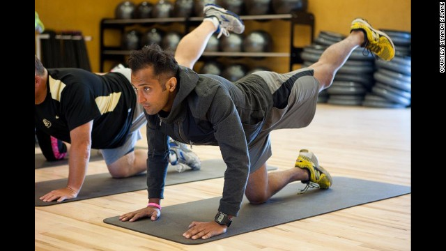 Jamil Nathoo works his hamstrings and gluteus maximus. Nathoo <a href='http://www.cnn.com/2014/03/07/health/fit-nation-jamil-cancer/'>is a cancer survivor</a>; he was training for an Olympic triathlon before he was diagnosed. Now he's determined to finish what he started.