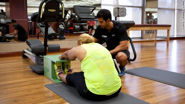 "Manns reaches forward during a stretch test at the gym. She's had two hip replacements, but says she's ""<a href='http://www.cnn.com/2014/03/14/health/fit-nation-karen-hips/'>too young not to run.</a>"""