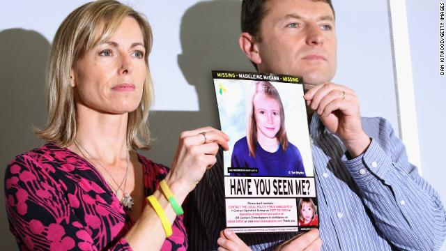 The McCanns hold an age-progressed police image of Madeleine during a May 2012 news conference to mark the fifth anniversary of her disappearance.