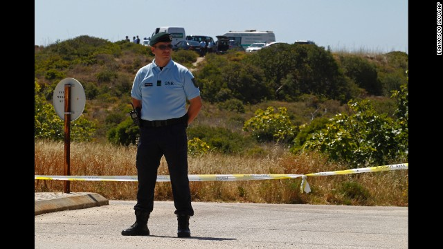 A Portuguese Republican Guard policeman stands guard as police begin digging in an area of wasteland near Praia da Luz on Monday, June 2.