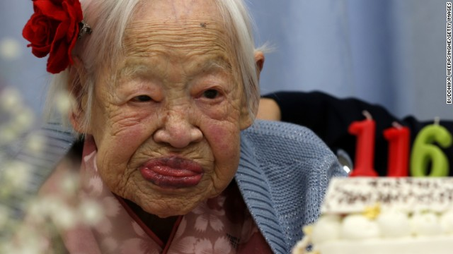 The oldest living woman alive is Misao Okawa, a 116-year-old from Japan. She was born March 5, 1898, and had three children. Her husband died in 1931. She kept in shape throughout much of her life. At 102, she said she did leg squats to keep healthy. She didn't start using a wheelchair until she turned 110. She currently lives in a nursing home.