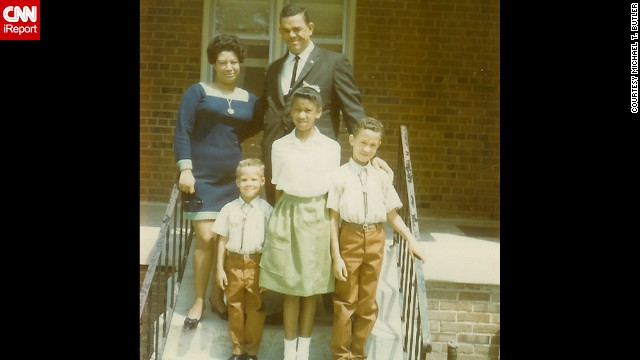 "<a href='http://ireport.cnn.com/docs/DOC-1119904'>Michael T. Butler</a>, the little guy in the front row, and his well-dressed family members are seen here in front of their home in Upper Marlboro, Maryland, in June 1969. ""Life was slower, many of us hated the pace, but when we grew up, we returned to what we had lost,"" he said. ""I moved back to the hometown of my youth because I was looking for what I had lost. Peace and quiet."""