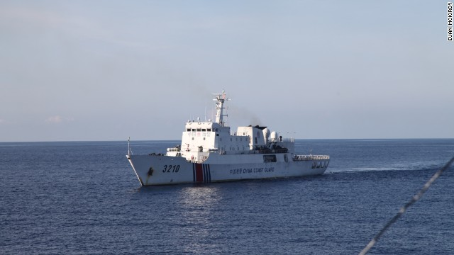 A Chinese Coast Guard vessel closely follows CG 8003.