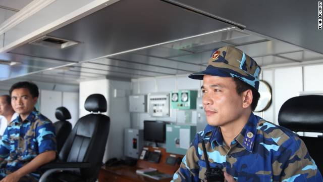 Captain Nguyen Van Hung mans the bridge.