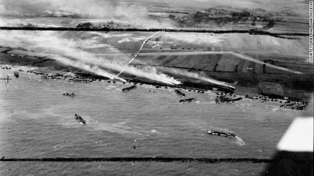 The British Army's 50th Infantry Division lands on beaches in Normandy. This photograph is part of an exhibit in London at the <a href='http://www.iwm.org.uk/history/d-day' target='_blank'>Imperial War Museum</a>.