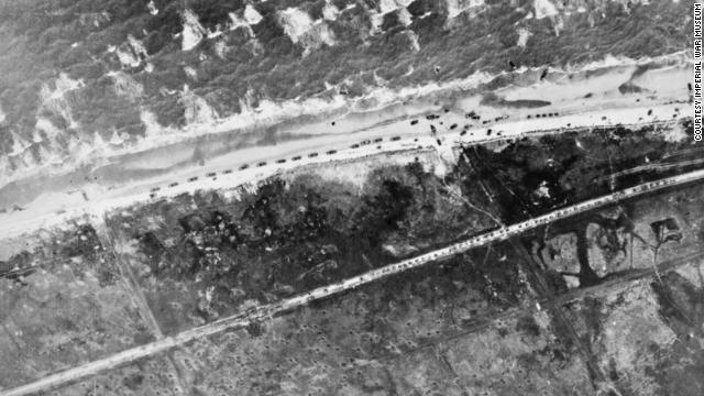 Traffic builds up on the beach and on the road leading to Le Hamel, France, during the landing of the 50th Infantry Division.