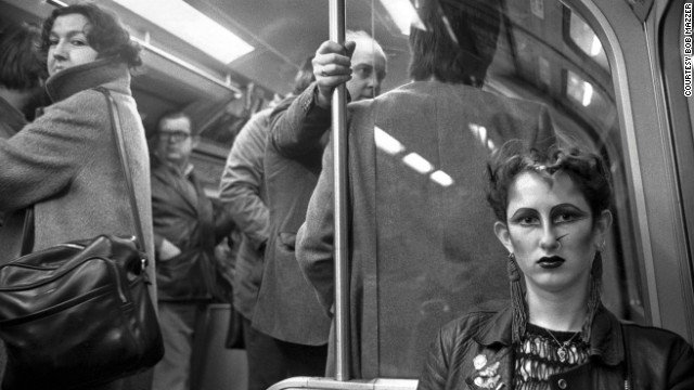 "Another Mazzer favorite, from the mid '80s, is of this woman with a nose piercing. ""I love the fact the other woman turned around just at that moment and is kind of looking at me a bit suspiciously,"" Mazzer says, ""but the woman I'm photographing is just giving me the straight eyeball."""