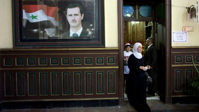 A woman leaves a polling station at an old train station in Damascus on June 3.