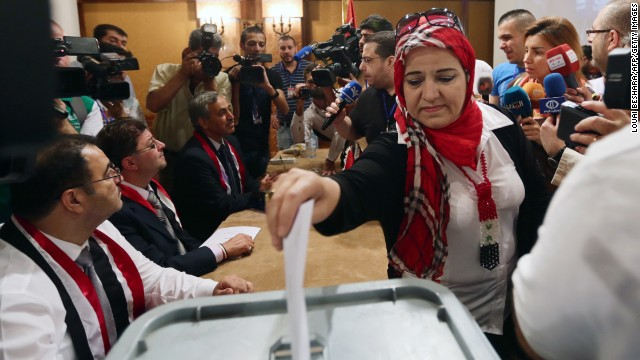 A woman casts her ballot June 3 in Damascus.