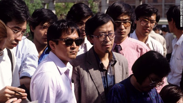 Jaime A. FlorCruz, then a TIME reporter, is seen in dark sunglasses in a crowd of journalists covering events in Beijing in 1989.