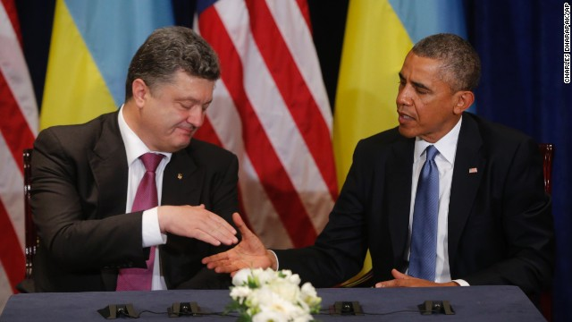 "Obama meets with Ukrainian President-elect Petro Poroshenko in Warsaw on June 4. Obama voiced his support for Poroshenko and called for the international community to ""stand solidly behind"" him as his government tries to quell a pro-Russian separatist uprising in the country's east."