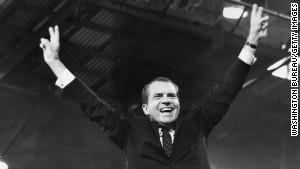 Nixon gives the victory sign after winning the presidential nomination at the GOP Convention in August, 1968.