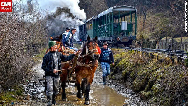 Locals walk with their horses through Vaser Valley in Viseu de Sus, Romania, where the only other way up the mountain is by scenic stream train.