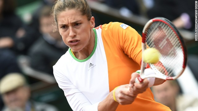 Andrea Petkovic booked her place in the semifinals of the French Open Wednesday with a 6-2 6-2 win over Italy's Sara Errani. The German, who contemplated retiring from tennis a year ago after suffering a number of injuries, will play Simona Halep for a place in the final.