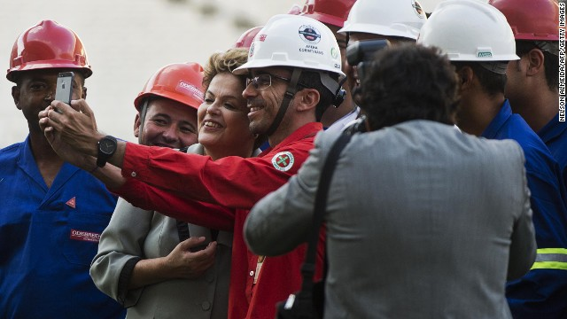 President Rousseff poses for a selfie with construction workers during a visit to the Arena Corinthians Stadium on May 8, 2014 which will host the opening match of the 2014 FIFA World Cup.