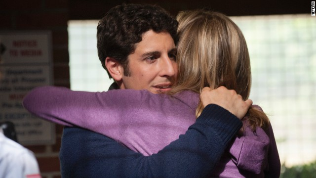Jason Biggs plays Larry Bloom, a journalist and Chapman's (formerly) doting fiancé. He stood by her in season one even when the more sordid details of her past were revealed, but becomes increasingly disenchanted and eventually exploits her prison sentence to bolster his career.