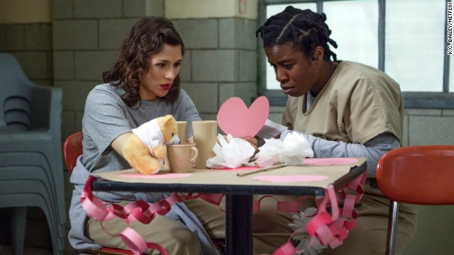"Lorna, left, with Suzanne ""Crazy Eyes"" Warren (Uzo Aduba), a disruptive inmate who takes a special liking to her ""Dandelion,"" Chapman. Her more sensitive side is revealed later in season one."