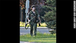 Police posted to social media a photograph of a man dressed in fatigues, carrying what appeared to be a rifle.