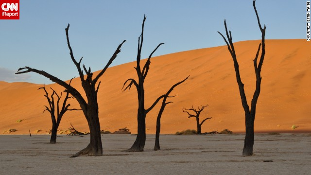 """Completely otherworldly"" is how <a href='http://ireport.cnn.com/docs/DOC-1138980'>Estin Yang</a> describes his visit to Sossusvlei in Namibia's<a href='http://www.namibiatourism.com.na/pages/national+parks' target='_blank'> Namib-Naukluft National Park</a>. He and his wife camped out at the gates two hours before sunrise to make sure they could reach the sand dunes in the perfect light."