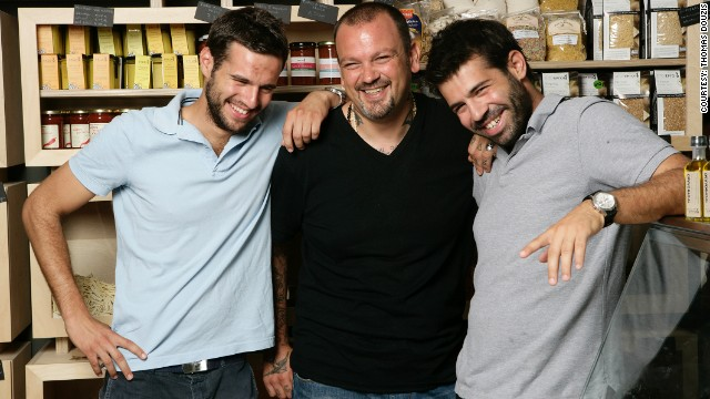 The Douzis brothers, pictured with chef Dimitris Skarmoutsos (center) set up their business at the start of the crisis.