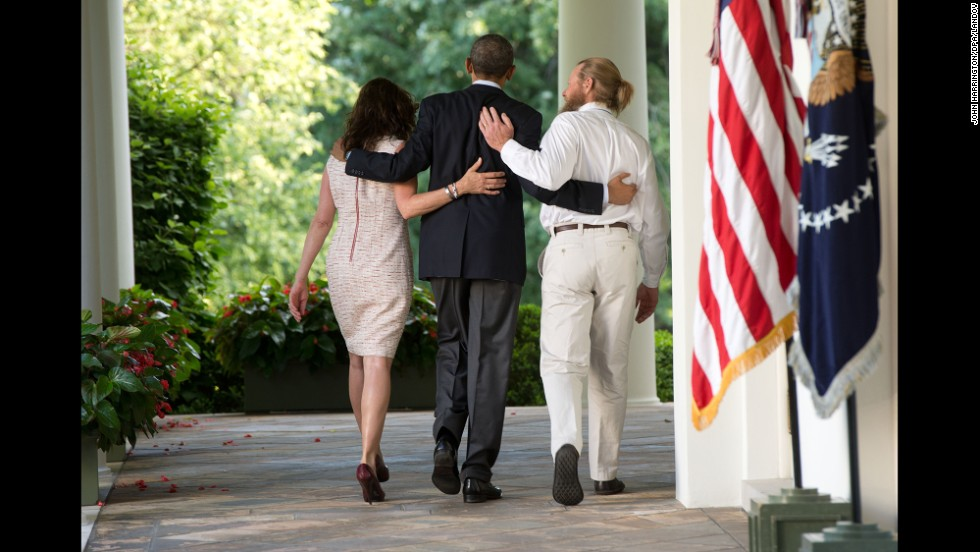 U.S. President Barack Obama, center, walks with the parents of Army Sgt. Bowe Bergdahl after making a statement about <a href='http://www.cnn.com/2014/05/31/world/asia/afghanistan-bergdahl-release/index.html'>Bergdahl's release</a> Saturday, May 31, at the White House in Washington. Bergdahl had been held captive in Afghanistan for nearly five years, and the Taliban released him in exchange for five U.S.-held prisoners.