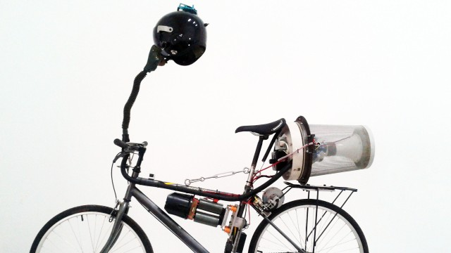 """British artist Matt Hope attached a small generator to a bike's back wheel and as he pedals, electricity is produced to power his homemade filtration system. He says it's """"an ironic commentary about living in China."""""""