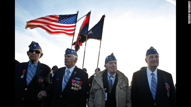JUNE 6 - NORMANDY, FRANCE: World War II veterans of the U.S. 29th Infantry Division attend a D-Day commemoration on Omaha Beach, where the allied forces landed 70 years ago. World leaders are taking part in the <a href='http://edition.cnn.com/2014/06/06/world/europe/d-day-commemoration/index.html?hpt=hp_t1'>ceremonies in honor of the largest seaborne invasion in history</a>.