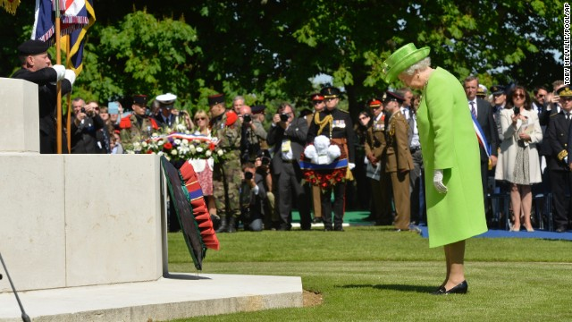 Queen Elizabeth pays her respects after laying a wreath during a ceremony at the British War Cemetery in Bayeux, France.