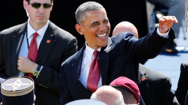President Obama waves during a D-Day ceremony.