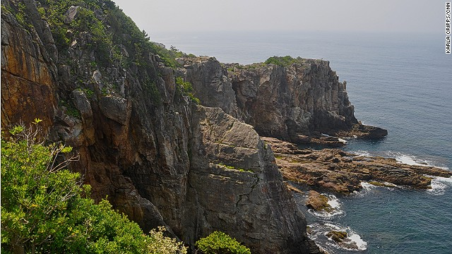 An elevator takes visitors beneath Shirahama's Sandanbeki cliffs to underground caves where the ocean rushes in. There's also a small exhibit showing how Japanese pirates once used the cliffs and caves as hiding spots.