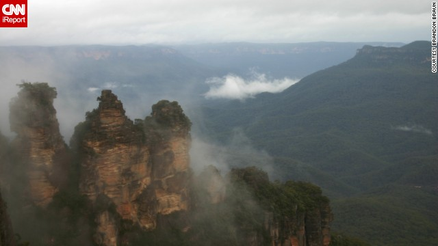 "Australia's <a href='http://www.environment.nsw.gov.au/NationalParks/parkHome.aspx?id=N0004' target='_blank'>Blue Mountains National Park</a> is home to the Three Sisters sandstone peaks, towering amid the cliffs of the Jamison Valley. Take a walk from there into the rain forest, where you're surrounded by waterfalls, says <a href='http://ireport.cnn.com/docs/DOC-1141272'>Brandon Braun</a>, who visited in 2008. ""The quiet and peacefulness of the area is enchanting."""