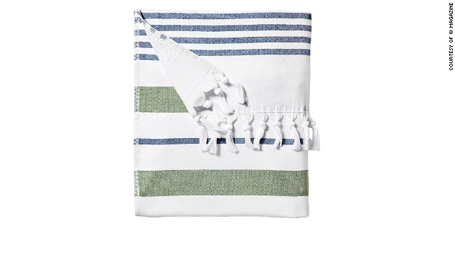 This Turkish-inspired towel doubles as a sarong out. Serena & Lily Fouta Beach Towel, <a href='serenaandlily.com' target='_blank'>serenaandlily.com</a>.