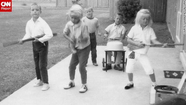 "<a href='http://ireport.cnn.com/docs/DOC-1137102'>Mora Pieti-Alcorn</a> took this photo as the younger kids followed his and his friends' lead in putting on a ""Beatles show"" in their Oceanside, California military neighborhood in the summer of 1964. ""How carefree our summer days were,"" she remembered. ""Living on base is very uniting and even though military families move around a lot you always seem to end up together again and again through out the years."""