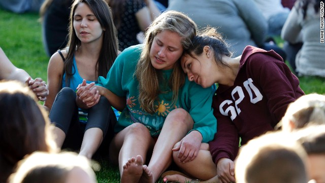 Students gather in a prayer circle June 5 after a church service was full.