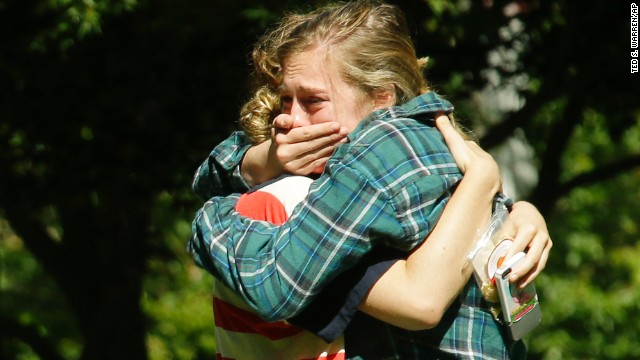 Two women embrace near a prayer circle Friday, June 6, on the campus of Seattle Pacific University. A day earlier, a gunman entered the school's science and engineering building, shot three people and was reloading a shotgun when a student subdued him, police said.