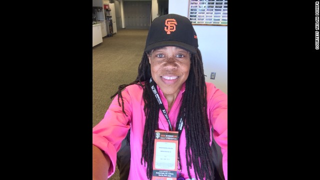 """Now 222 or so pounds lighter, she feels a new kind of confidence. """"I even walk different,"""" she said. She stayed home at first so she could watch her diet closely, but now she ventures out. This photo was taken at a happy day in the press box in May."""